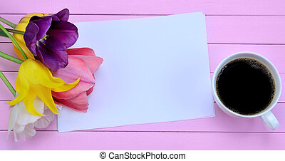 Empty paper with flowers and coffee cup on table