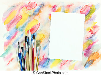 empty paper sheet with various paintbrushes over colorful diagonal watercolor strokes background