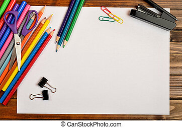 Empty paper with school accessories