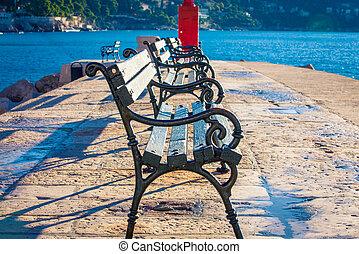 empty park bench in Dubrovnik
