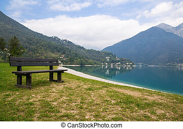 empty park bench on the lake