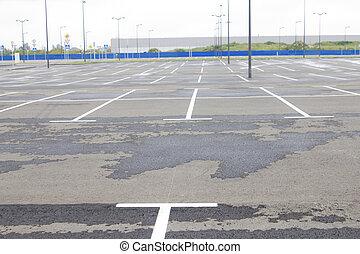 Empty parking area near supermarket