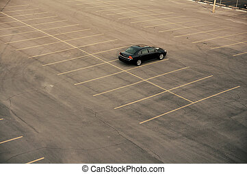 An empty parking lot in Kansas City at 6 pm.