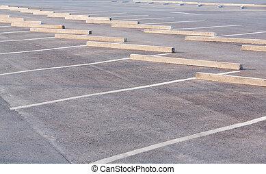 Empty parking lots with concrete car stop