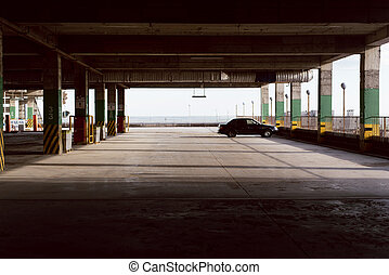 Empty parking. One car in the parking space