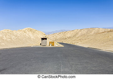 empty parking place at death valley under blue sky