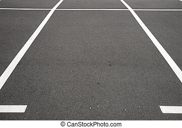 Empty parking place with white marking lines on asphalt