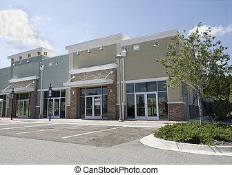 empty pastel strip mall