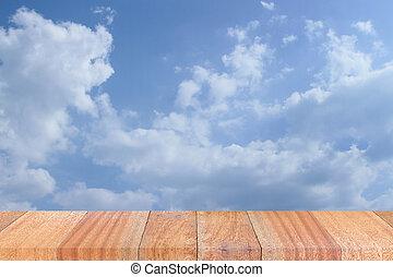 Empty perspective wooden plank floor with sky