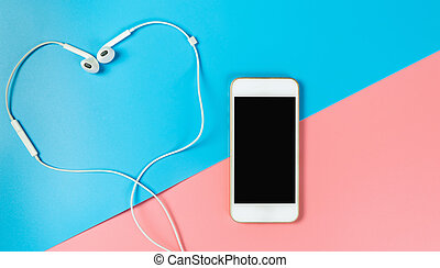 Empty phone screen and heart earphone for love concept