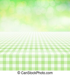 Empty picnic gingham tablecloth, green background