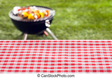 Empty picnic table background covered in a fresh country red...