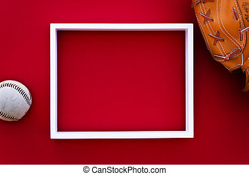 empty picture frame on a red wall