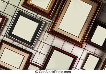 Empty Picture Frames on Wall