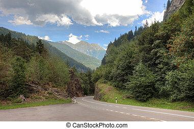 Empty picturesque road in swiss Alps, Europe.