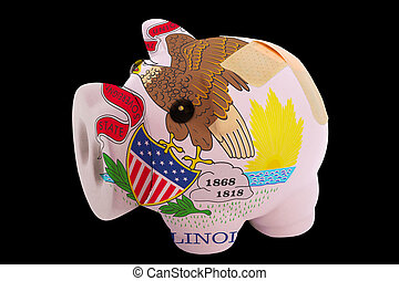 empty piggy rich bank in colors of flag of us state of illinois on black background