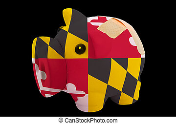 empty piggy rich bank in colors of flag of us state of maryland on black background
