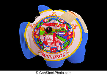 empty piggy rich bank in colors of flag of us state of minnesota on black background