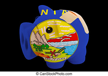 empty piggy rich bank in colors of flag of us state of montana on black background