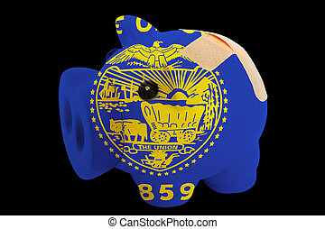 empty piggy rich bank in colors of flag of us state of oregon on black background