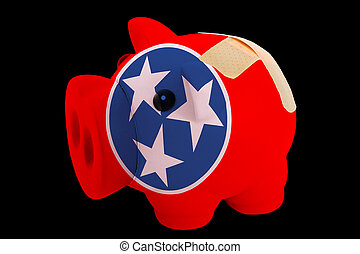 empty piggy rich bank in colors of flag of us state of tennessee on black background