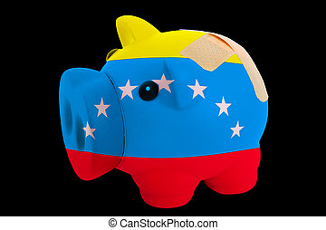 empty piggy rich bank in colors of flag of us state of vermont on black background
