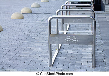 Empty place for bicycles parking, modern metal bike lock racks outdoors