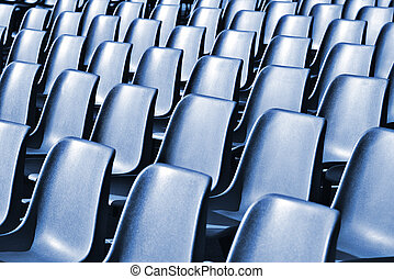 Empty Plastic Chairs at the Stadium