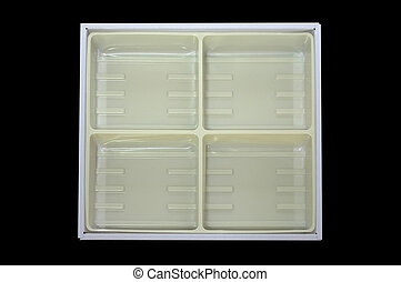 Empty plastic tray inside paper box