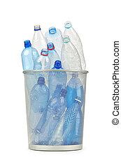 Empty plastic water bottles on white