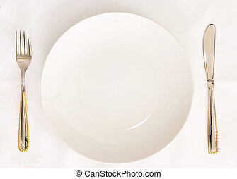 Empty plate - An empty plate on a linen cloth -...