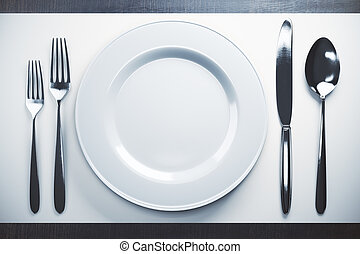 Empty plate and cutlery