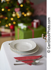 Empty plate for unknown guest