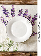 Empty plate laid on vintage wooden dining table
