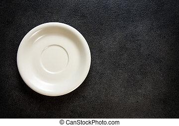 Empty plate on chalkboard black background