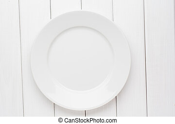 Empty plate on white wooden background. Top view with copy space