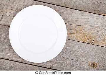 Empty plate on wood table