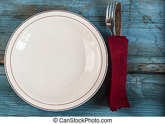 Empty plate on wooden table