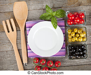 Empty plate on wooden with fruits and utensils