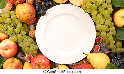 empty plate with autumn fruit