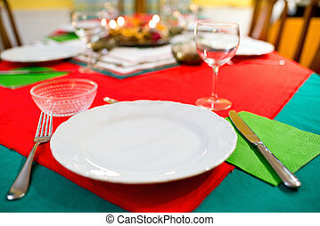 Empty plate with cutlery on the table.