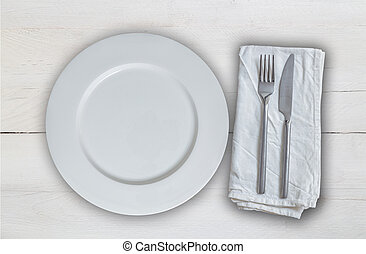Empty plate with cutlery on white vintage wood