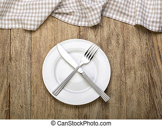 Empty plate with silver cutlery
