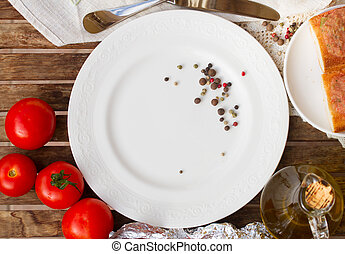 empty plate with tomatoes and olive oil
