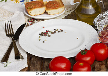 empty plate with tomatoes
