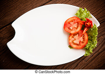 empty plate with tomatoes waiting for food