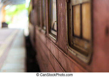 Empty platform of a railway station in Sri Lanka. Old rusty train cars. It looks like an abandoned place, but it is not