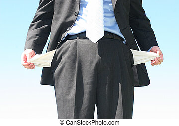 Business man wearing black suit and blue shirt is holding out his empty pockets