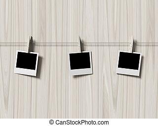 empty polaroid photos frames on wood background