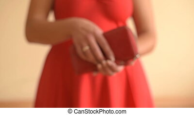 Empty purse in women's hands